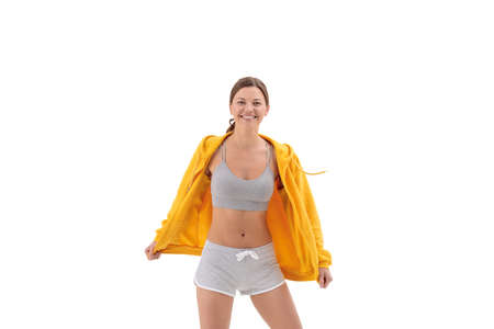 Portrait of smiling fitness young woman weared in yellow sweetshot