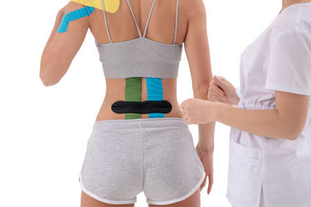 dynamic functional bandage with taping on the female back isolated on white background 免版税图像