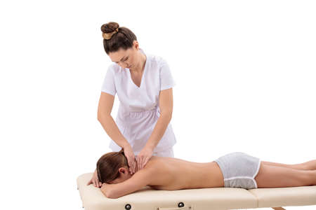 Physiotherapist doing neck massage to her female patient isolated on white background