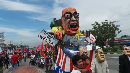 pres: Effigy of Pres. Aquino as puppet of the US is paraded during the anti-state of the nation address protest held in Quezon City