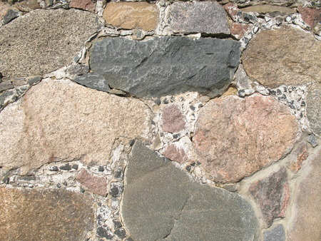 driven: background from stones. laying. densely driven squared stones