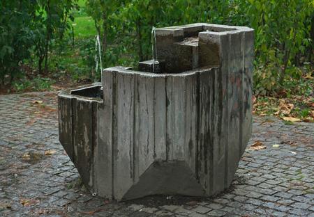Small concrete fountain in Danube park, Novi Sad, Serbia Stock Photo