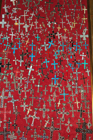 Large number of crosses in display case for sale