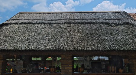 Reed roof on Serbian traditional shed, close up Redactioneel