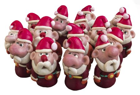 Santa Clauses  from modeling clay.   Santa Clauses  on a white background.