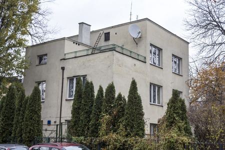 Houses built in the twenties and thirties of the twentieth century in city Warsaw , Poland. Residential building in a cozy and quiet city street. Editorial
