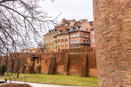 The area of the Old Town in Warsaw, Poland . The citys medieval wall and old houses.
