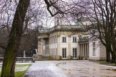 pilasters: Summer Royal Palace Lazienki during winter thaws. City of Warsaw, Poland. North facade in the style of classicism.  Stock Photo