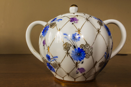 Porcelain sugar bowl with golden pattern and blue flowers. Hand-painted old sets. Imperial Porcelain Factory.