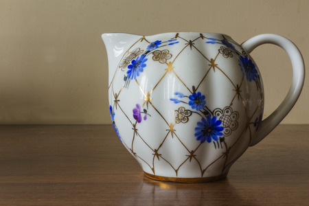 antique factory: Porcelain milk jug with a golden pattern and blue flowers. Hand-painted old sets. Imperial Porcelain Factory.