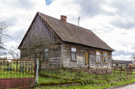 Abandoned wooden house in the village. The house is built of spruce beams. Joining the walls at the corners through dovetail joint . Region Podlasie, Poland. Reklamní fotografie