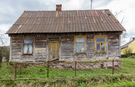 Abandoned wooden house in the village. The house is built of spruce beams. Joining the walls at the corners  through dovetail joint . Region Podlasie, Poland. Stock Photo