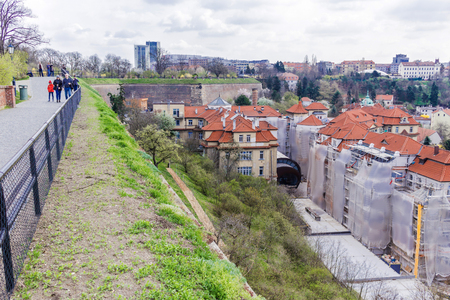 The view from  Vyshegrad rock to city of Prague in the early spring on a sunny day. Area of the old town in Prague, Czech Republic.