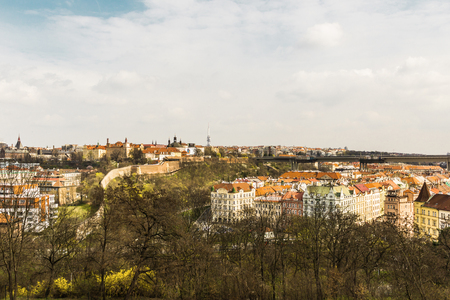 reverberation: The view from  Vyshegrad rock to city of Prague in the early spring on a sunny day. Area of the old town in Prague, Czech Republic.