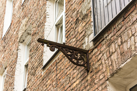 Decorated brackets protruding from the wall. The remains of the balcony on the house, built in the late 19th century.