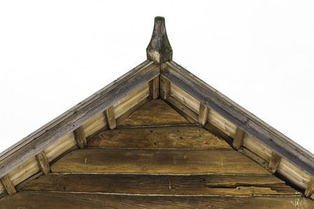 Wooden restored barn. Built in the 18th century. Triangular pediment of logs. Interesting photo for the site about construction, history. Stock Photo