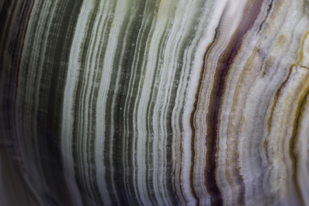 Macro photo texture of polished onyx stone. Photo for the site about geology, stones, jewelry, handwork, textures, art.