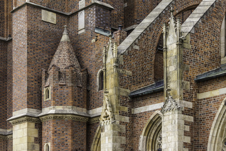 Details of the cathedral in the Gothic style. The side facade,flying buttress, sculptures,decor. Cathedral of St. John the Baptist in Wroclaw, Poland.