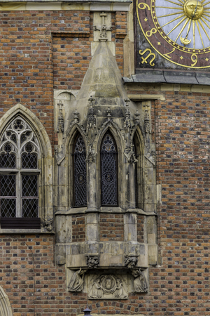 Detail of the facade of the medieval Town Hall. Windows, clocks, stone decoration. Mixed style of architecture - Gothic and Baroque. Vroslav,Poland.