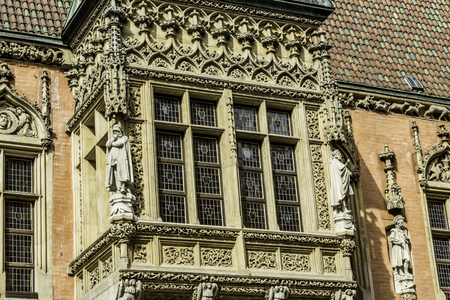 Detail of the facade of the medieval Town Hall. Windows,sculptures,stone decoration.Mixed style of architecture - Gothic and Baroque. Vroslav,Poland. Archivio Fotografico
