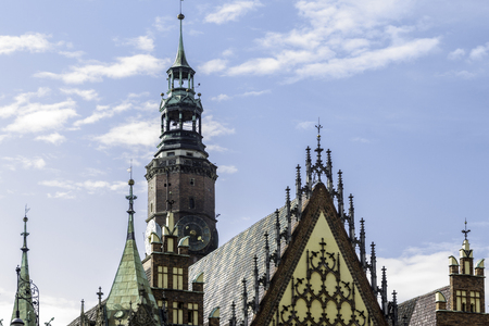 Facades, roofs , sculptures,stone decoration and towers of the medieval Town Hall. Mixed style of architecture - Gothic and Baroque. Vroslav, Poland.