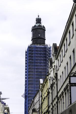 Repair of the church in the Gothic style. High tower, western facade. Scaffolding, blue grid. St. Elizabeth Church o in Wroclaw,Poland.