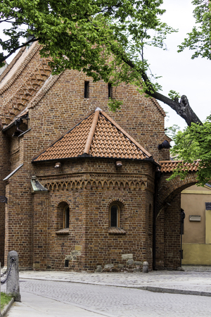 Old brick church in Romanesque style. Apse on the east side and Dumpling gate.Tile, brick decoration. St.Giles church in Wroclaw , Poland .