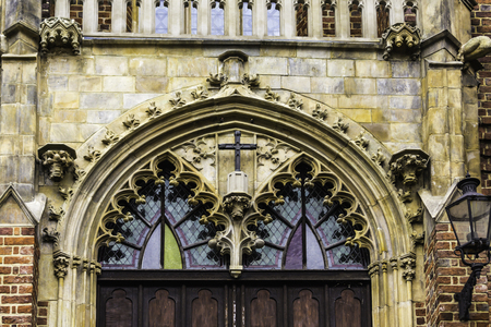 Entrance to the church in the Gothic style. Stone decoration, balustrade, stained glass.The Holy Cross Church in Wroclaw , Poland .