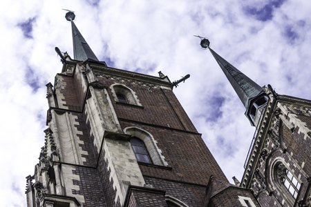 Two towers of the cathedral in the Gothic style. Facades,a copper spire, sculptures,stone decor. Cathedral of St. John the Baptist in Wroclaw, Poland. Editoriali