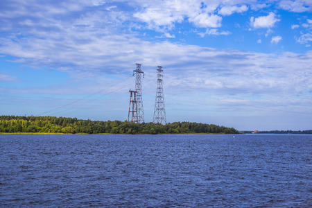 The Volga River near Konakovo. Electric power transmission above the river. Central Russia.Background for the site about travel, electricity.
