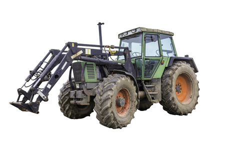 General view of a powerful tractor designed for various works on a country farm. Closed saloon, red wheels. Isolated photo.Equipment for a dairy farm.