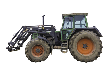 Side view of a powerful tractor designed for various works on a country farm. Closed saloon, red wheels. Isolated photo.Equipment for a dairy farm. Zdjęcie Seryjne