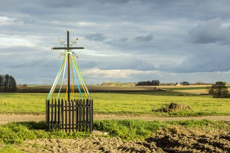 Late autumn. Cross standing at the crossroads.Close-up. Old Christian tradition. Podlasie, Poland.