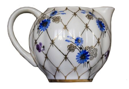 Isolated porcelain milk jug . Side view . Blue flowers and a golden net. Hand painted.White background .Imperial Porcelain Factory.
