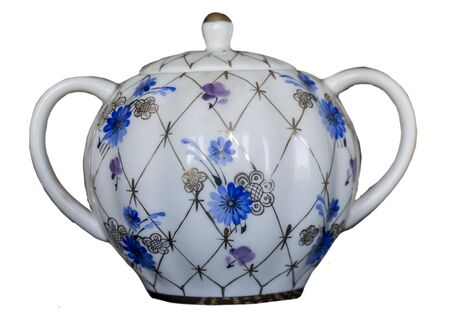 Isolated porcelain sugar bowl .Side view . Blue flowers  and golden net.Hand painted.White background . Imperial Porcelain Factory.