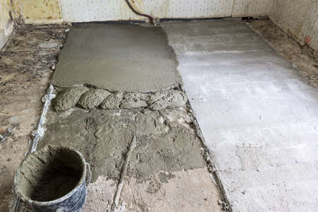 Repair in the apartment in the kitchen that was built forty years ago. Pouring concrete screed on the old floor.