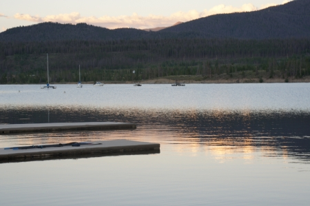 lake dillon: Reflection on mountain lake with boats at sunset