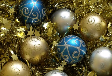 baubles for christmas blue gold and silver decorations on gold tinsel stock photo 3832602 - Blue And Gold Christmas Decorations