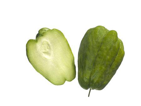 organic choko Sechium edule vegetable pear cut in half Foto de archivo