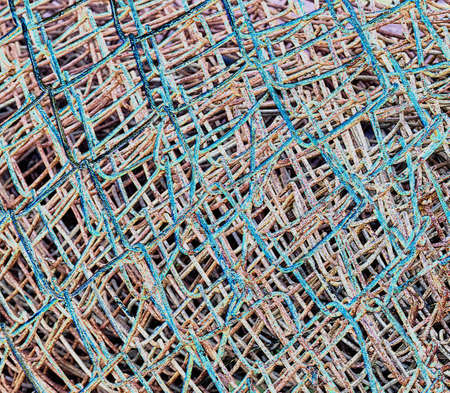 rusty wire: blue criss cross rusty wire abstract background Stock Photo