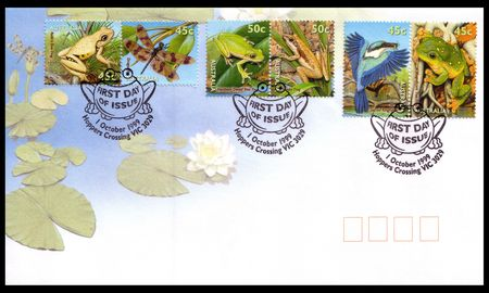 postmarked: Australia - circa 1999: an Australian Post First Day Cover mailing envelope with stamps depicting frogs, sacred kingfisher and dragonfly postmarked Hoppers Crossing Victoria Stock Photo