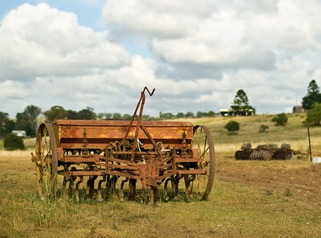 rural Australia old vintage rusty farm machinery for cultivation plough tiller with cloudy sky Stock Photo - 11571949