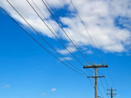 electricity power lines in australia with blue sky background