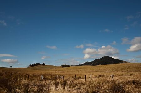 Australian dry winter pasture treeless landscape with clouds buiding in blue sky Stock Photo - 14386044