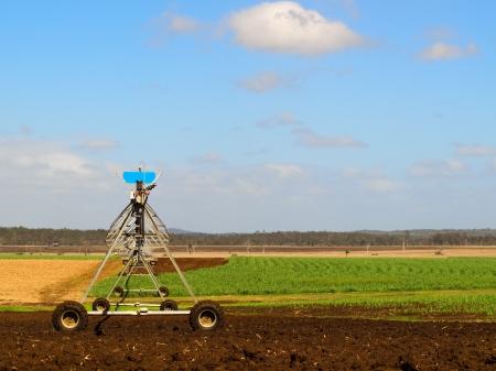 Australian Agriculture Ploughed sugarcane field with irrigation equipment rural landscape scene Foto de archivo