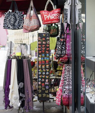 sidewalk sale: Colorful gifts and souvenirs in french street markets on sidewalks in paris