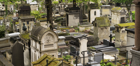 christian halloween: Old and ancient moss covered stone Crypts and Tombstones in a Graveyard in Europe Stock Photo