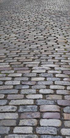 cobblestone road: Old  traditional european style long narrow  cobblestone road background with granite blocks, stones and brickwork pattern