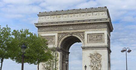 triumphe: Arc de Triumphe monument popular tourist destination Paris with blue cloudy sky
