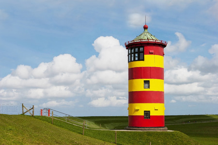 Historical Lighthouse at the North Sea in Germany s Pilsum  Todays is used for weddings  Stock Photo